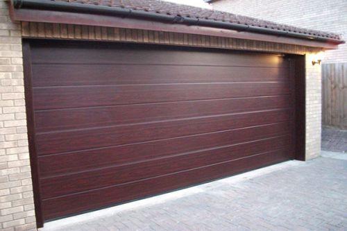 Секционные ворота – удобный вариант для гаража